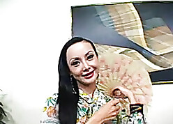 Beautiful Asian MILF rides a broad in the beam colourless horseshit