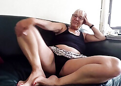 Wan haired granny poses to hand camera